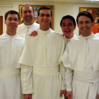 Students from St Michael's Abbey, Frater Pio Vottola, Frater Frederick Schmit, Frater Anselm Rodriguez, Frater Clement Hurtgen, Frater Julian Tsai, Frater Peregrine Fletcher, and Frater Peter Adrian Miller