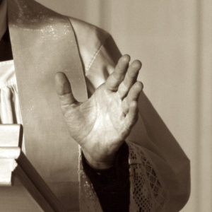A hand of a preaching priest